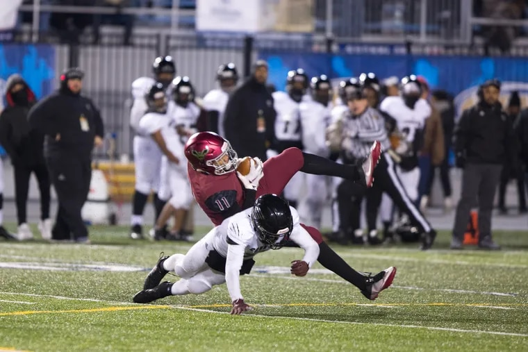 St. Joe's Prep wideout Johnny Freeman (11) catches a pass across the middle against Harrisburg in the PIAA Class 6A final at HersheyPark Stadium.