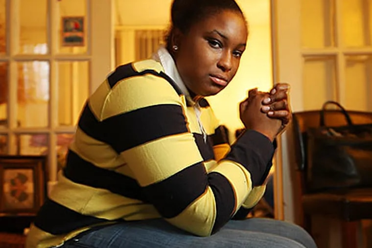 Ronada Cyrus had been working as a seasonal worker and was laid off. She can not get unemployment because of Pennsylvania regulations. (Michael Bryant/Staff )