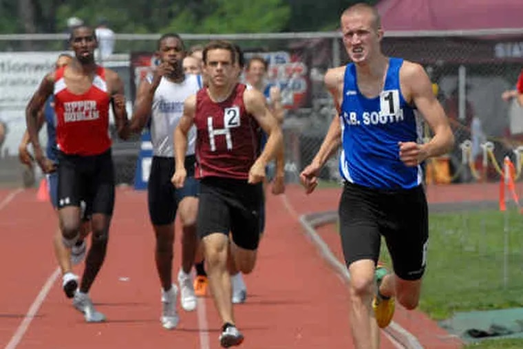 Central Bucks South's Tom Mallon puts some distance between him and the pack during his record run in the 800 meters.
