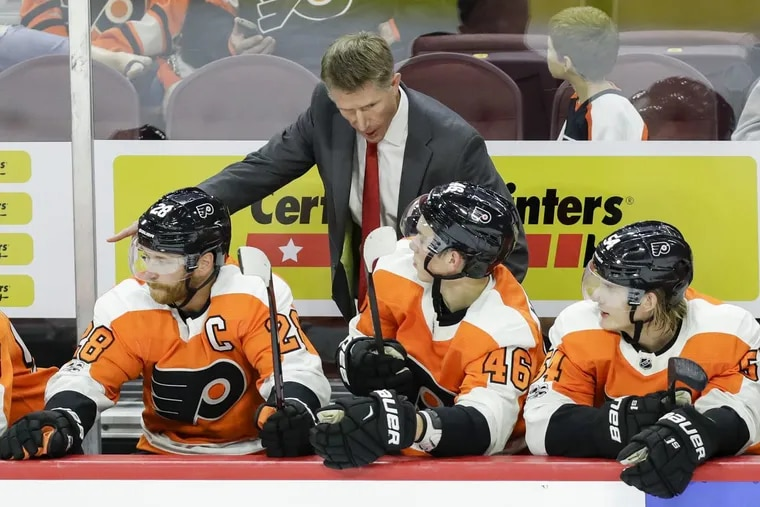 Flyers Head Coach Dave Hakstol with center Claude Giroux, center Mikhail Vorobyov and left wing Oskar Lindblom against the New York Rangers in a preseason game on Tuesday, September 26, 2017 in Philadelphia.