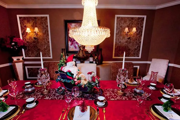 Santa Claus, in his sleigh , enjoys a place of honor even on the Fiorentinos' dining room table. DAVID M WARREN / Staff Photographer