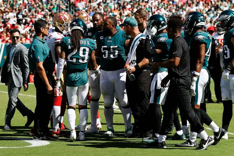 Eagles defensive end Brandon Graham is surrounded by teammates after rupturing his Achilles tendon in last Sunday's loss to the 49ers.