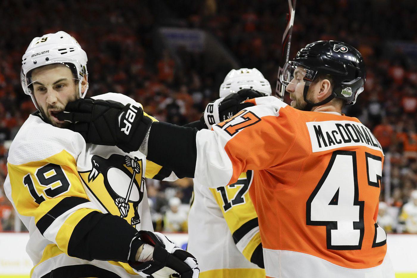Flyers defenseman Andrew MacDonald eyes return; Morgan Frost, Isaac Ratcliffe sent to juniors