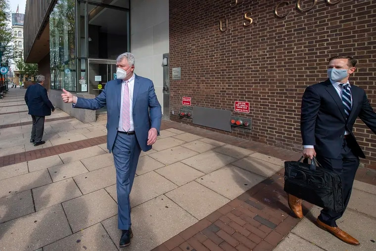 Labor leader John Dougherty (left) leaves the federal courthouse Monday after the first day of his federal bribery and corruption trial.