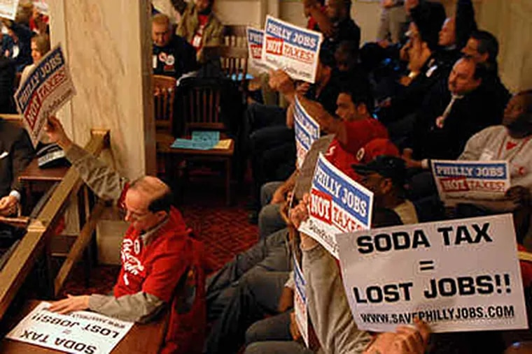 A tax on sugary drinks is one way the Nutter administration has proposed helping fund the Philadelphia School District, which is laying off 3,000 teachers. Here unions protest the proposal. (Alejandro A. Alvarez/File)