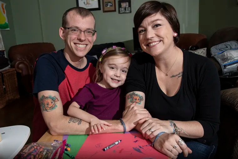 Havertown 4-year-old Scarlett Camburn had surgery to correct paralysis in her right arm. Her parents, Andrea and Chris, got matching Nemo tattoos because the Disney character's lucky right fin is small and weak.