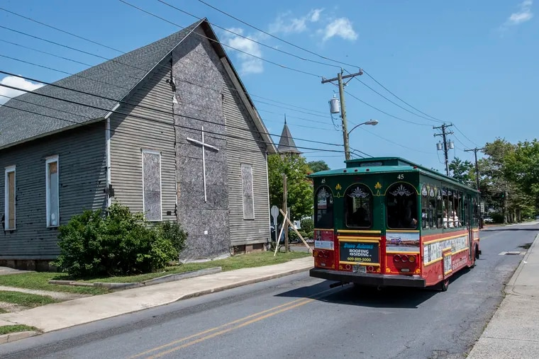 A tourist trolley rolls passed the 133-year-old the Allen African Methodist Episcopal (A.M.E.) Church, a Cape May landmark and cultural heirloom, which is set to be renovated and added to a collection of Black heritage sites that have been repurposed as community centers.