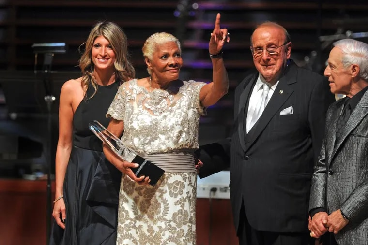 Dionne Warwick holds her 2017 Marian Anderson Award at the Kimmel Center during a gala concert event Tuesday night, November 14, 2017. With her are award board chairwoman Nina Tinari Schulson, record producer Clive Davis, and longtime Philadelphia DJ Jerry Blavat (right).
