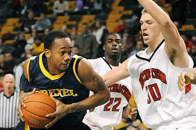 Drexel's Chris Fouch (left) drives against Northeastern's Ryan Pierson (right) during Drexel's 63-58 win. (AP Photo/Lisa Poole)