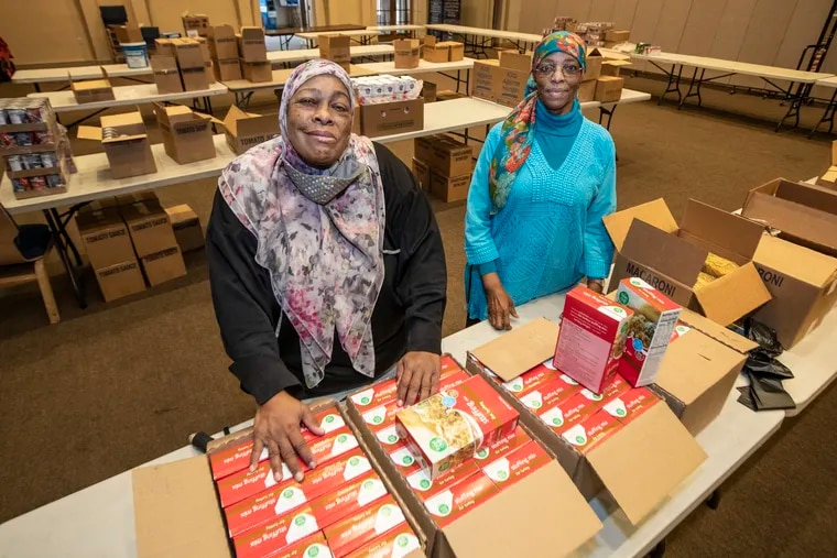 Gaye Nailah Johns, left, and her associate Wajeehah Rashed, right, have been feeding people for 20 years from their food bank at Masjidullah mosque in West Oak Lane.