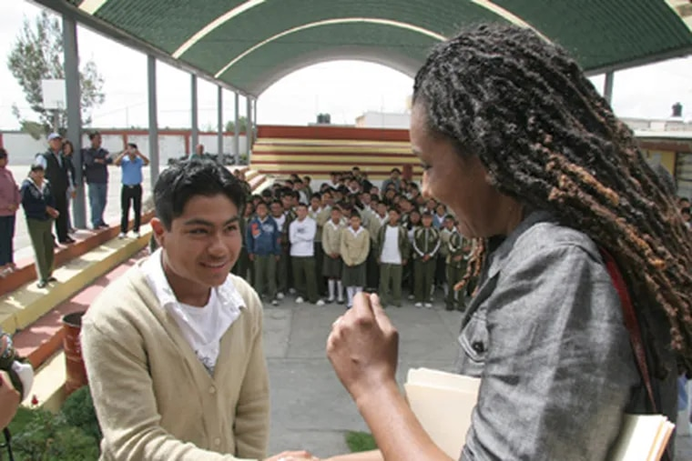 Philly's first lady, Lisa Nutter, meets with a student in San Mateo Ozolco, Mexico, during her June 2010 trip with the Siembra Azul Foundation. (DAVID SURO)
