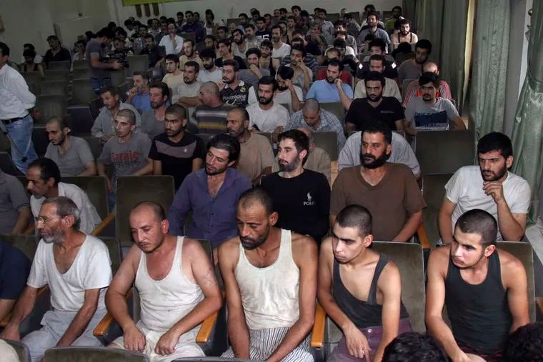 Syrian detainees who took part in antigovernment protests sit in a courtroom in Damascus, Syria. Human-rights groups say thousands have disappeared over the last two years.