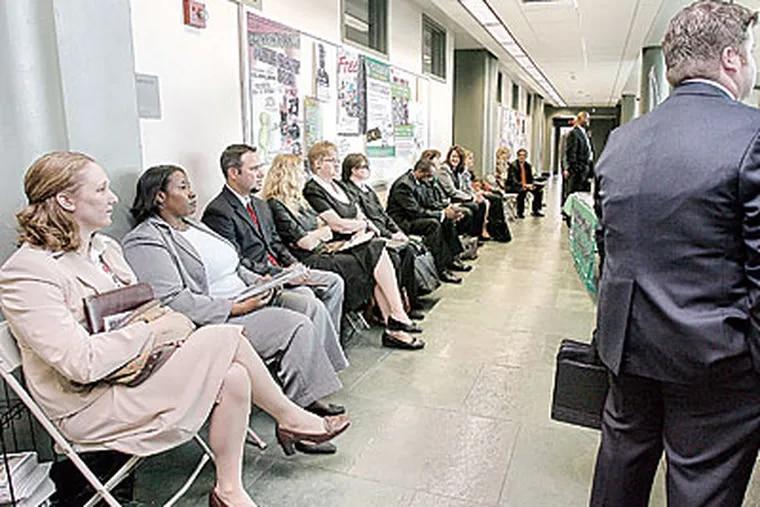 Applicants wait for their interview at Burlington Community College.(Akira Suwa /Staff Photographer )