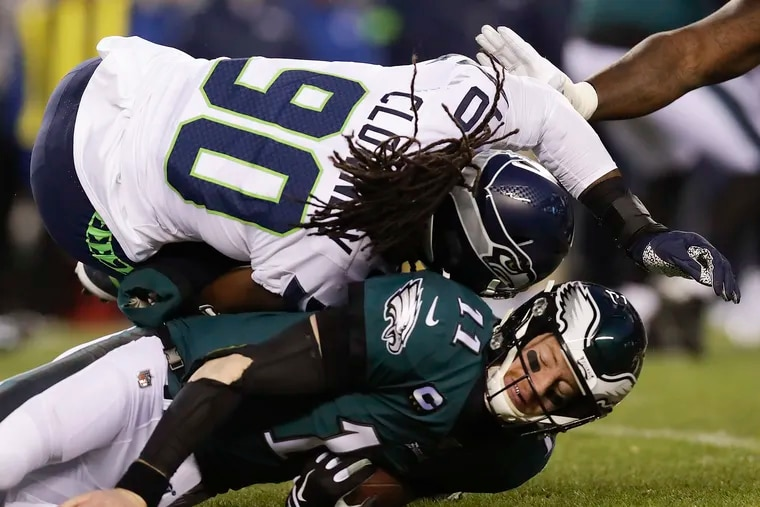Eagles quarterback Carson Wentz sustained a concussion from a helmet-to-helmet hit by Seattle Seahawks defensive end Jadeveon Clowney during the first quarter.