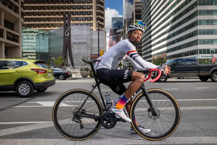 """Siddeeq Shabazz takes a rest on his bicycle, which he's named """"The Dark Knight,"""" outside of City Hall last week."""