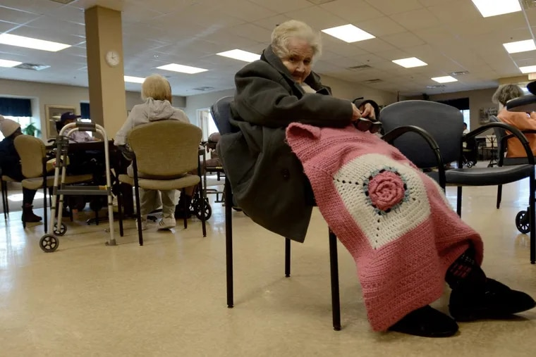 Mary Walsh, age 82, sits in the living room in the Adult Day Care Center, Active Day of Center City in South Philadelphia. Wednesday, January 3, 2018.