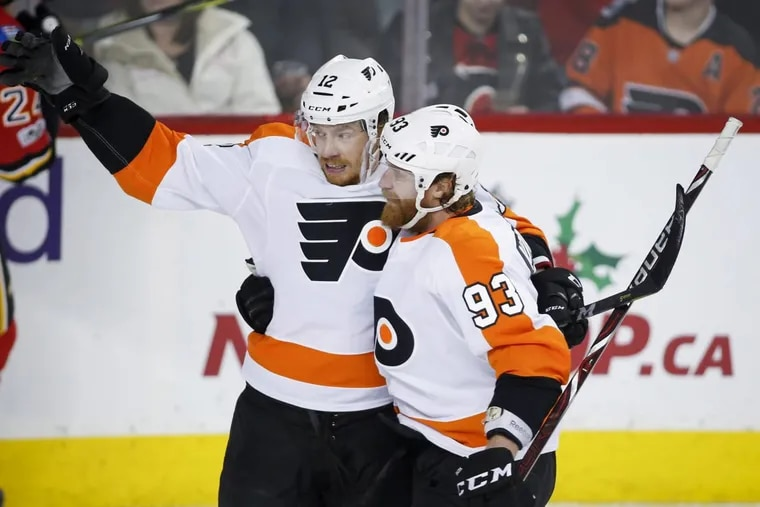 Michael Raffl, left, celebrates his goal with teammate Jake Voracek, during a recent game in Calgary.