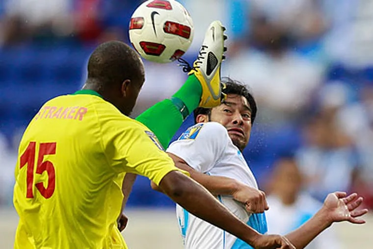 Though he has struggled with the Union, Carlos Ruiz remains a star with Guatemala's national team. (Julio Cortez/AP)