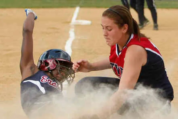 Washingtown Township pitcher Alissa Schoelkopf can't get the tag down as Eastern's Cherelle Chambers scores from second on her wild pitch in the fourth to give the Vikings the lead.