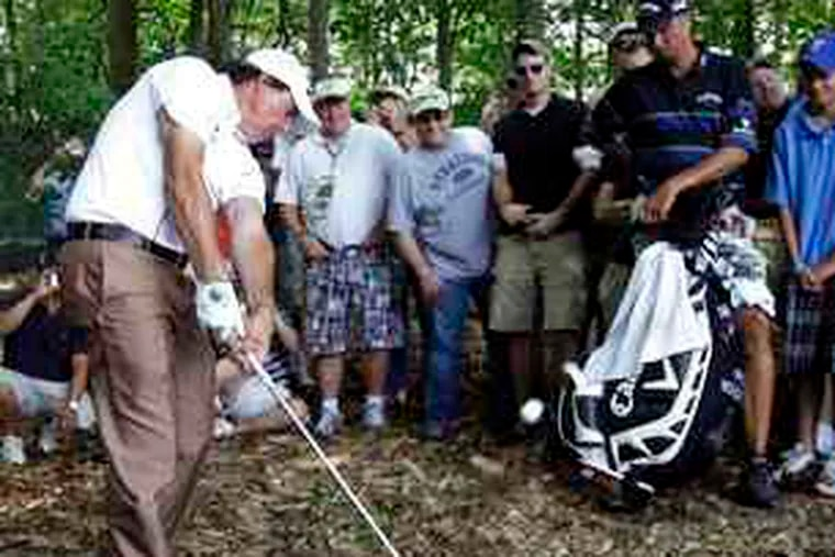"""Phil Mickelson hits out of the rough during practice for the U.S. Open at Bethpage Black. Tournament officials should resist calls to make the course """"a fairer test."""""""