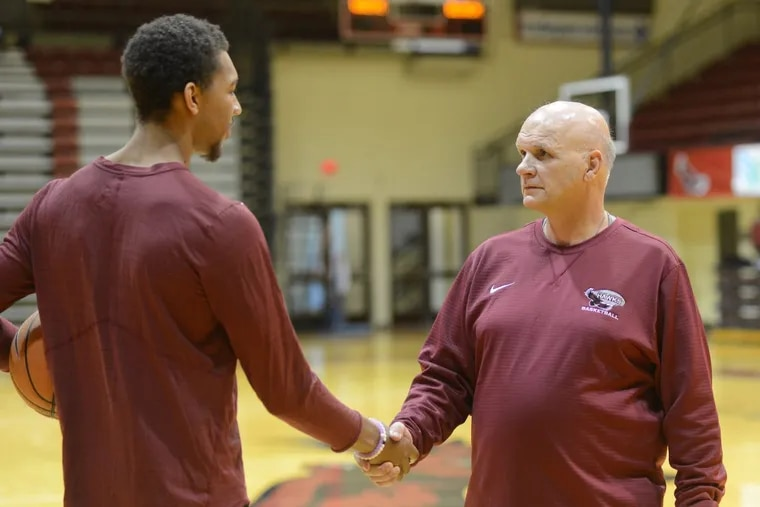 St. Joseph's University head basketball coach Phil Martelli (right) is greeted by player Charlie Brown, Jr. during St. Joseph's University basketball media day Thursday, November 02, 2017 at Hagan Arena in Philadelphia, Pennsylvania. (WILLIAM THOMAS CAIN / For The Philadelphia Inquirer)