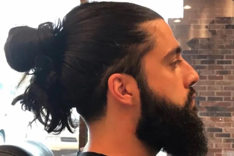 Alex Masis client Elias Bitar sports the perfect manbun and full beard.