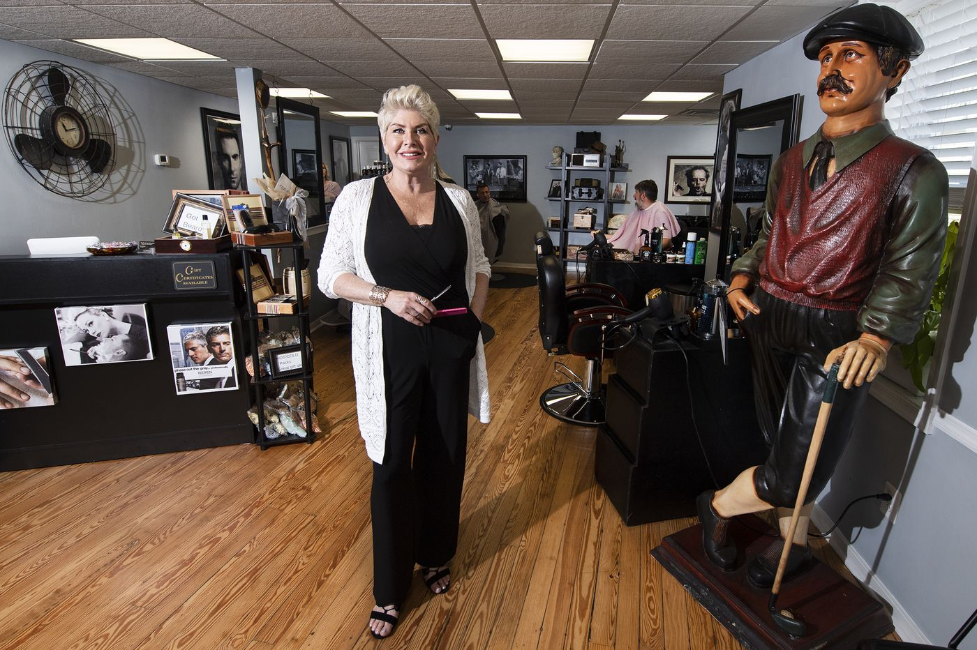 After raising three sons, she's running her own barber shop