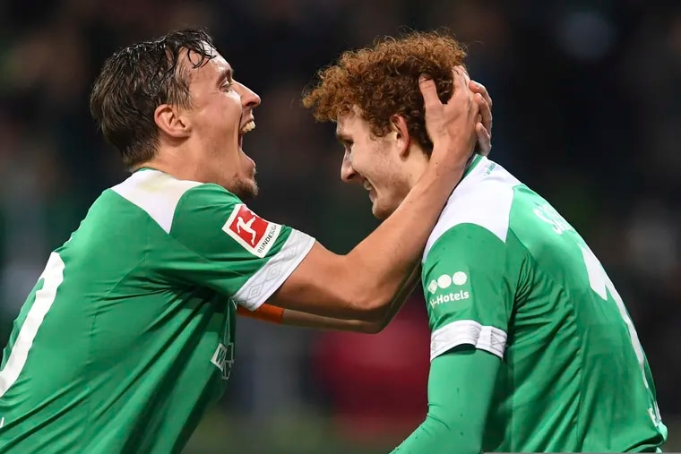 Werder Bremen's Josh Sargent (right) after scoring his first goal of his professional soccer career.