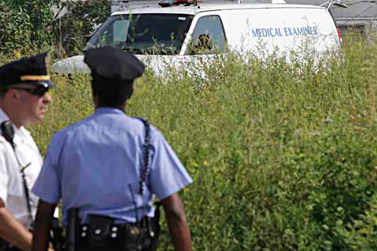 Near York and Sedgley Cops found chopped up body parts in a grassy field in Strawberry Mansion Friday, July 19, 2013.  (Steven M. Falk / Staff Photographer )