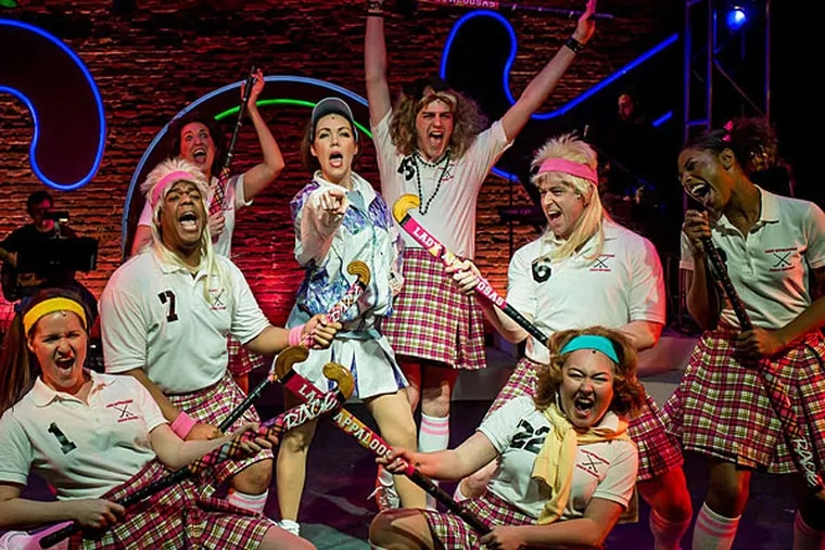 """Most of the cast of """"Field Hockey Hot,"""" 11th Hour Theatre Company's gung-ho, manic, gleeful, corny tale of a retro-'80s girls' field hockey team, by playwright and composer Michael Ogborn. (Chrissy K Photography)"""