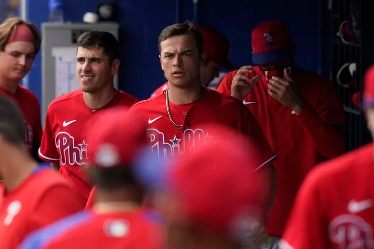 Catcher Logan O'Hoppe (center) hit .277 with a .783 OPS in his first 301 minor-league plate appearances.