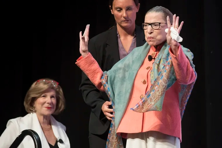 Supreme Court Associate Justice Ruth Bader Ginsburg waves to the audience at the Library of Congress National Book Festival in Washington in August.