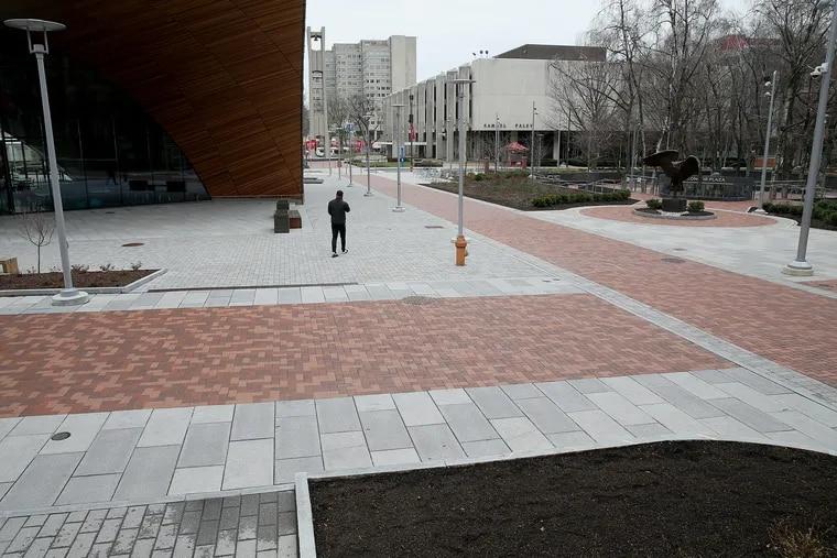 A man walks across the nearly empty Temple University campus in North Philadelphia last week.
