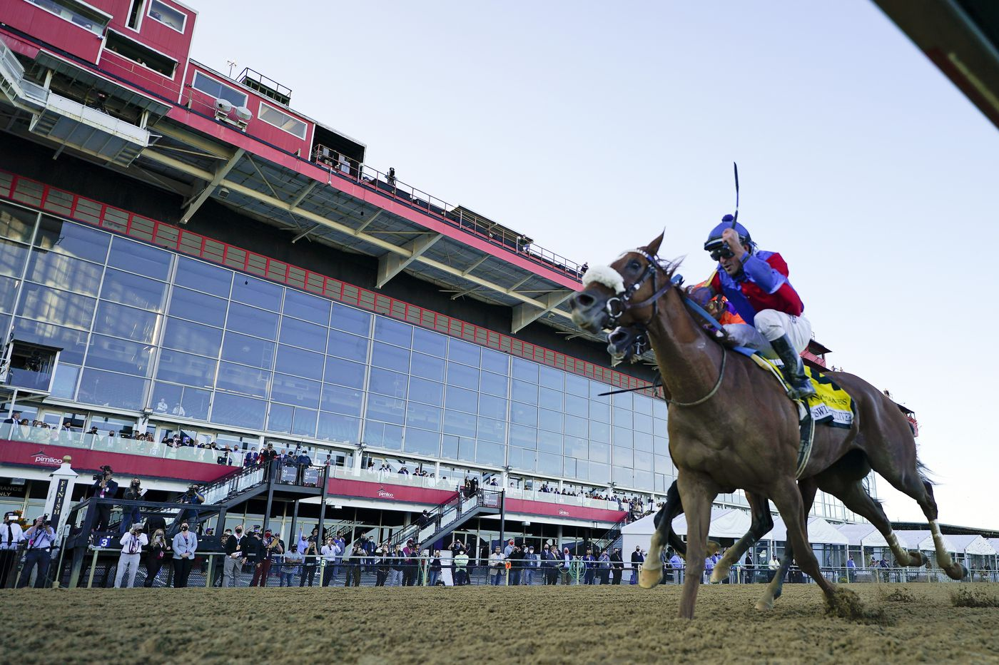 Swiss Skydiver wins Preakness, outrunning Kentucky Derby winner Authentic down the stretch