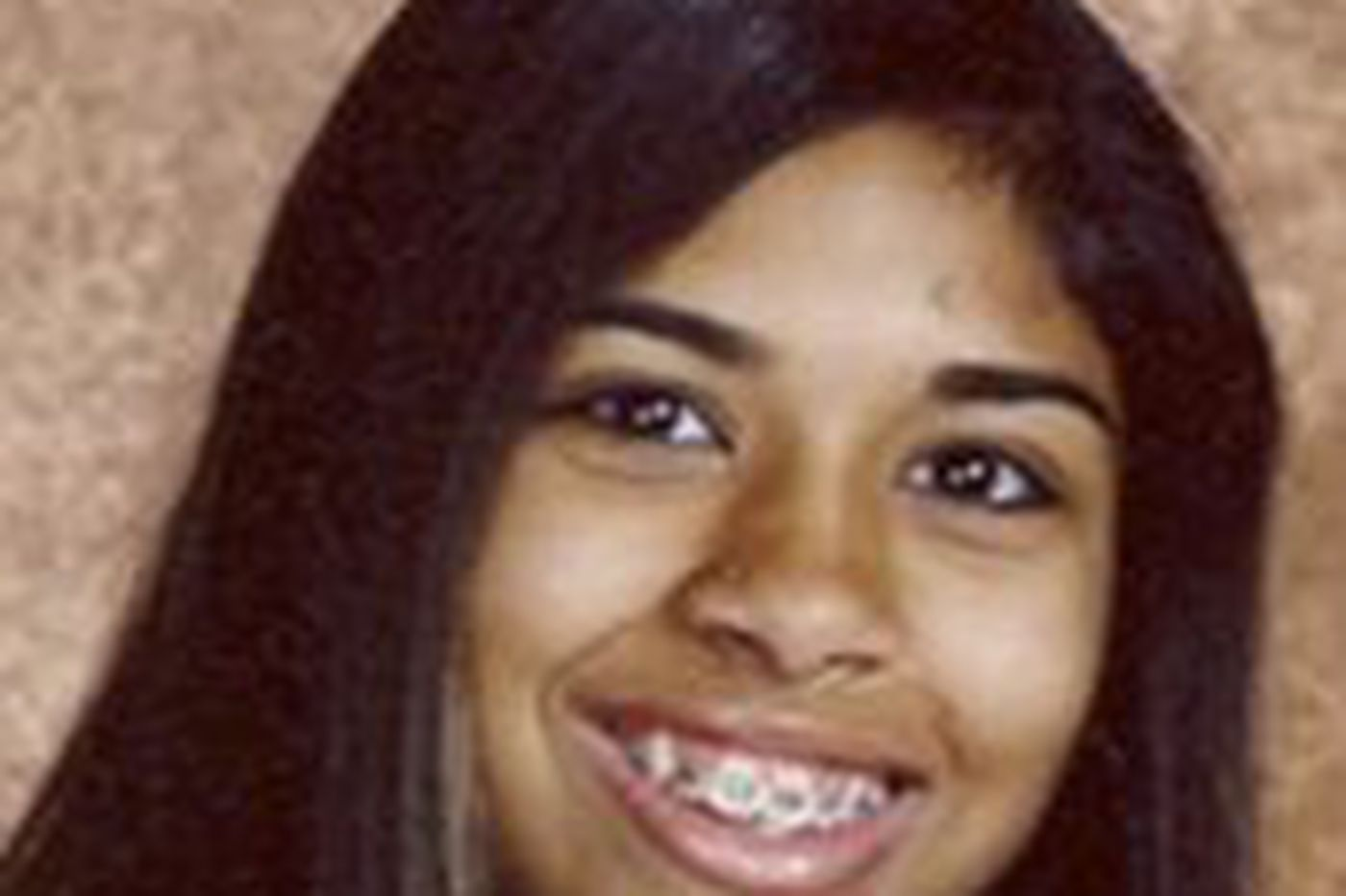 Slain teenager's mother charged
