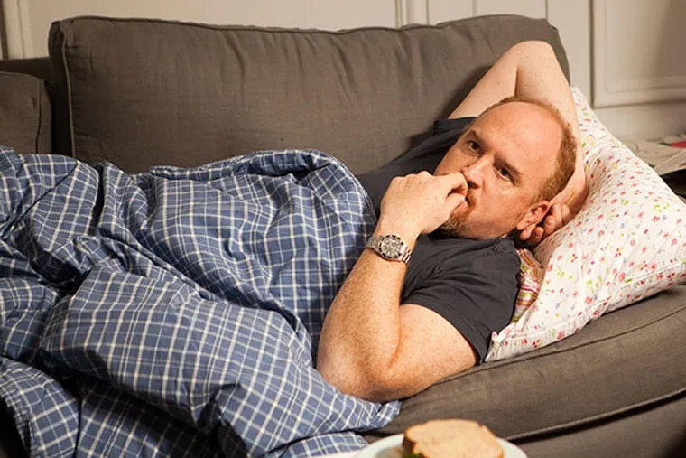 """This image released by FX shows Louis C.K. in a scene from """"Louie.""""  (AP Photo/FX)"""