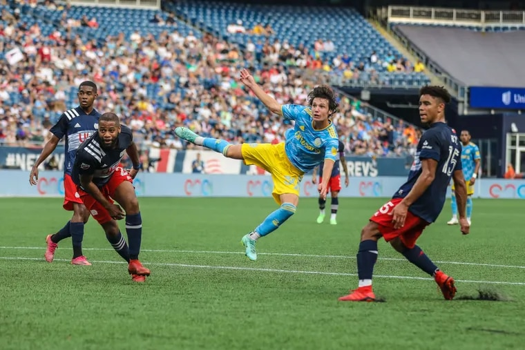 Paxten Aaronson watches his 31st-minute shot fly in for his first MLS goal.