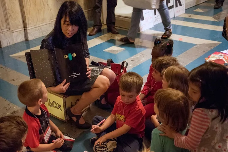 City Councilwoman Helen Gym reads to preschoolers before the City Council vote on a tax for sugary and diet drinks.
