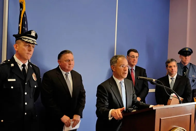 U.S. Attorney Paul Fishman, at the podium, is joined by other law enforcement officials as he announces the arrests of 16 people in what the FBI called its biggest drug bust in Camden in a decade. Other officials from left are Camden County Police Chief J. Scott Thomson; Edward Hanko, special agent in charge of the FBI Philadelphia Division, and Camden County Prosecutor  Warren Faulk. (Ed Hille/Staff Photographer)