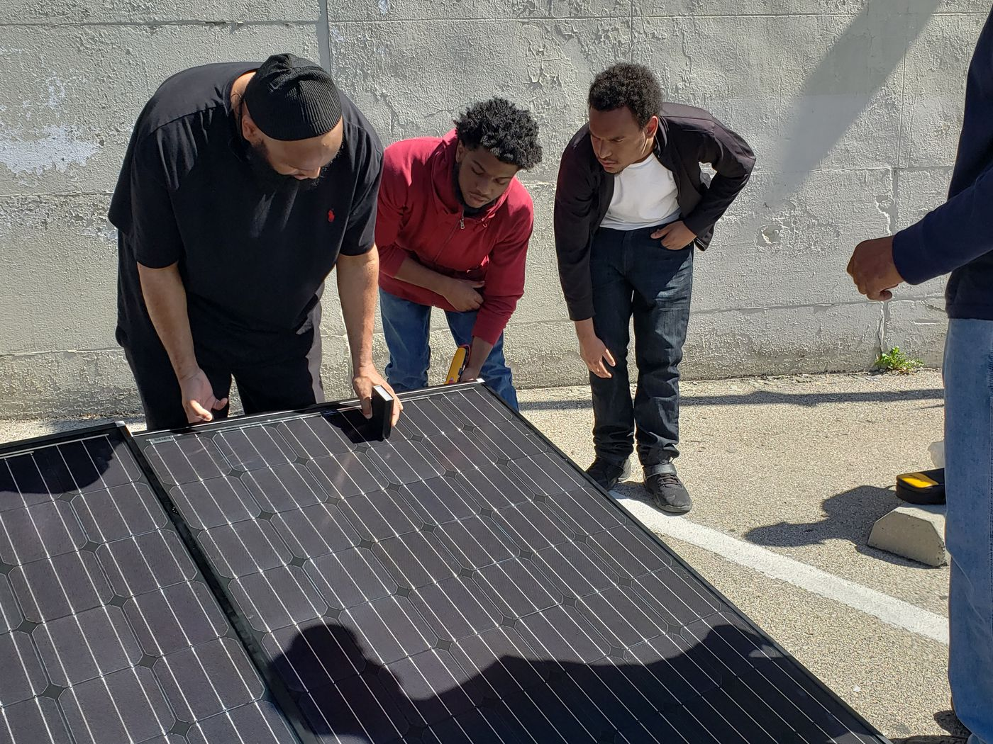 Free solar training programs line up jobs for unemployed in Philly's