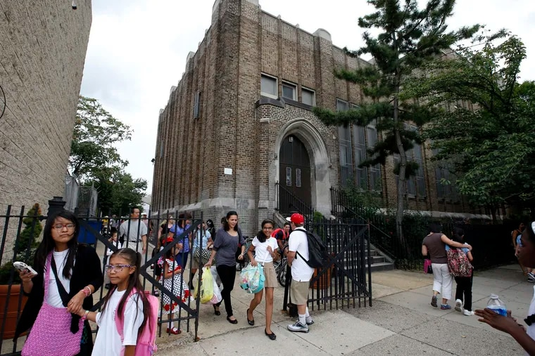 Students and guardians leave the first day of the new school year at the William M. Meredith Elementary School in Queen Village section in September 2014.  A Philadelphia teachers' union announced Sept. 11, 2019 last week that a Meredith instructor has lung cancer caused by asbestos.