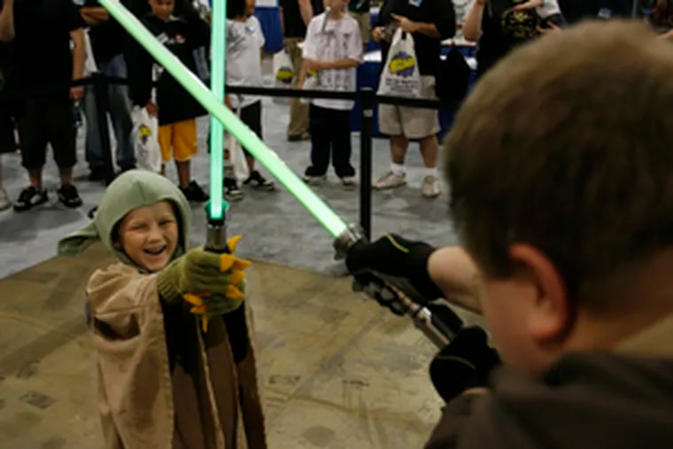 Use the (pop culture) force. Joseph Levengood, 6, of Lebanon, Pa., wields a light saber to do battle with Mike Zhang, 32, a member of a New York Jedi club, at Wizard World Philadelphia.