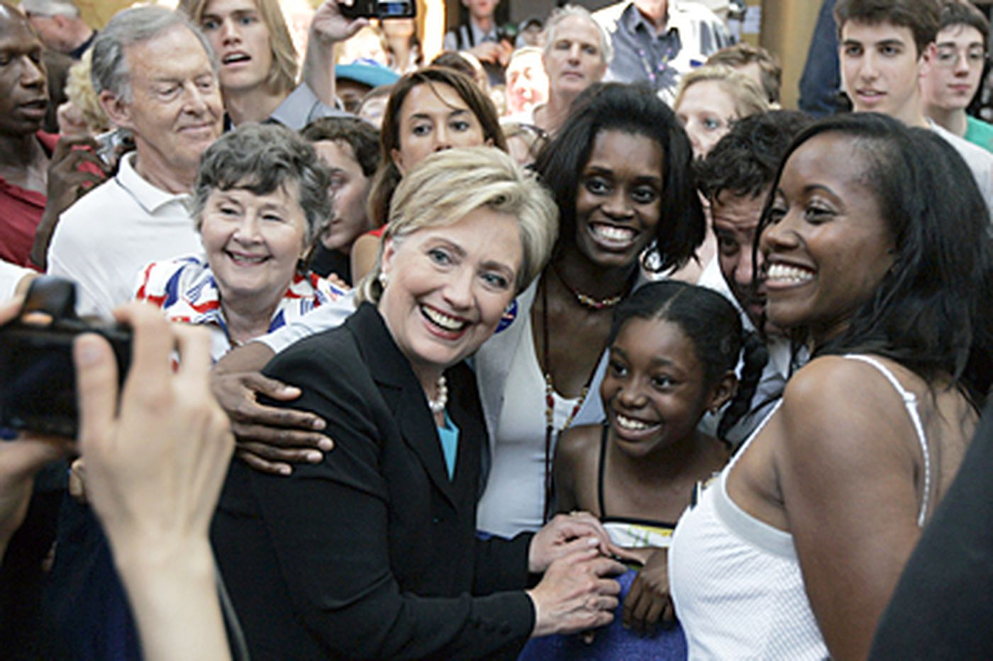 Clinton concedes and throws support to Obama