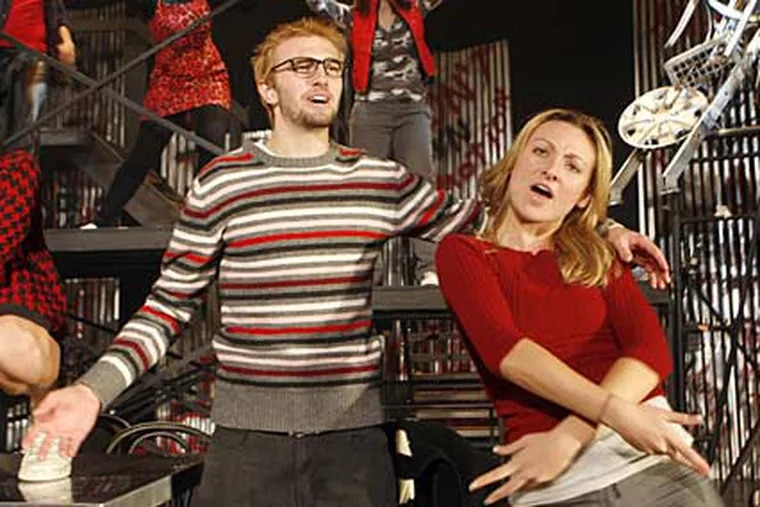 """Joe Fredericks and Derilyn Devlin rehearse a dance number for the world premiere of the high school version of """"Rent."""""""