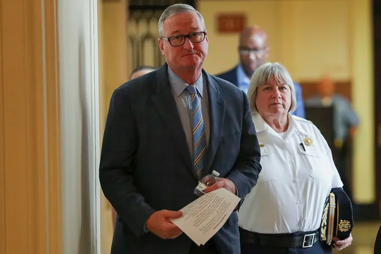 Mayor Jim Kenney (left) and new acting Police Commissioner Christine Coulter arrive for a news conference regarding the resignation of former Commissioner Richard Ross.