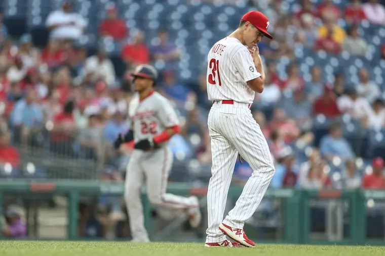 Phillies pitcher Matt Moore walks back to the mound after serving up a three-run homer to the Nationals' Juan Soto after he rounds third base in the background during the second inning at Citizens Bank Park in Philadelphia, Tuesday, July 27, 2021