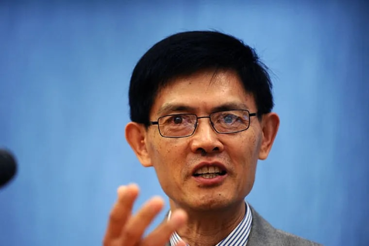 """""""I changed…from someone who was a free man to someone who was under indictment,"""" said Temple professor Xiaoxing Xi, who spoke at a panel discussion in D.C. (MARY F. CALVERT/For The Inquirer)"""