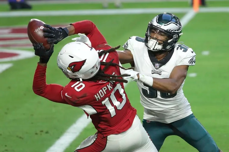 Cardinals wide receiver DeAndre Hopkins makes a touchdown catch over Eagles defensive back Michael Jacquet on Sunday.
