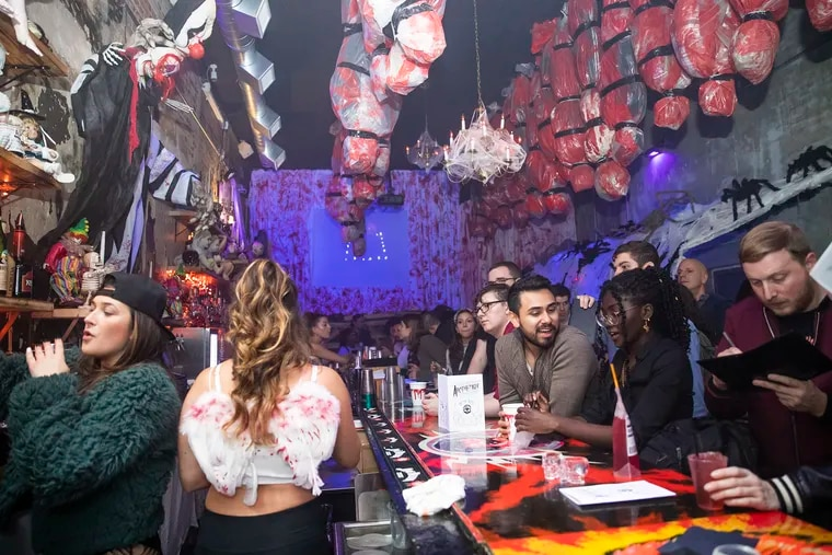 """The Halloween-themed """"The Nightmare Before Tinsel"""" pop-up bar in Center City draws a rowdy crowd on a mid-October evening."""
