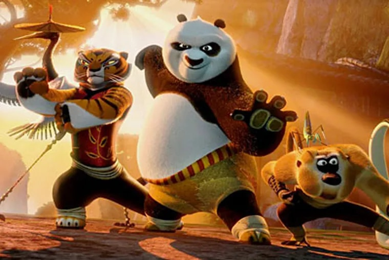 eady to battle against a horde of warrior wolves are (from left) Tigress, Po, and Monkey.